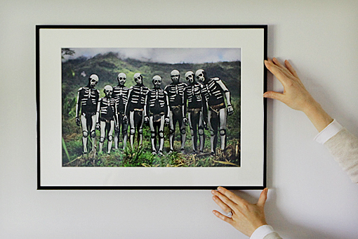 An A2 exhibition print in a black aluminium frame with soft white mount board